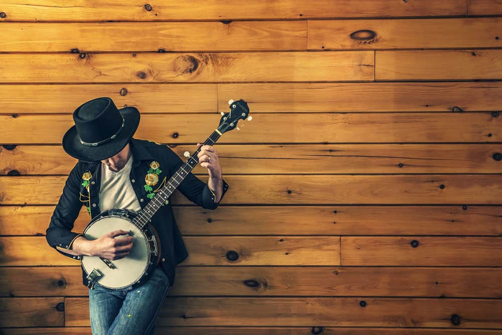 Banjo Player on Wooden Wall
