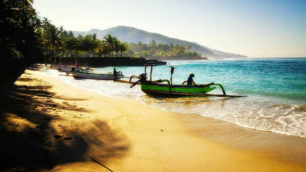 Boats along Beach in Candidasa, Bali, Indonesia