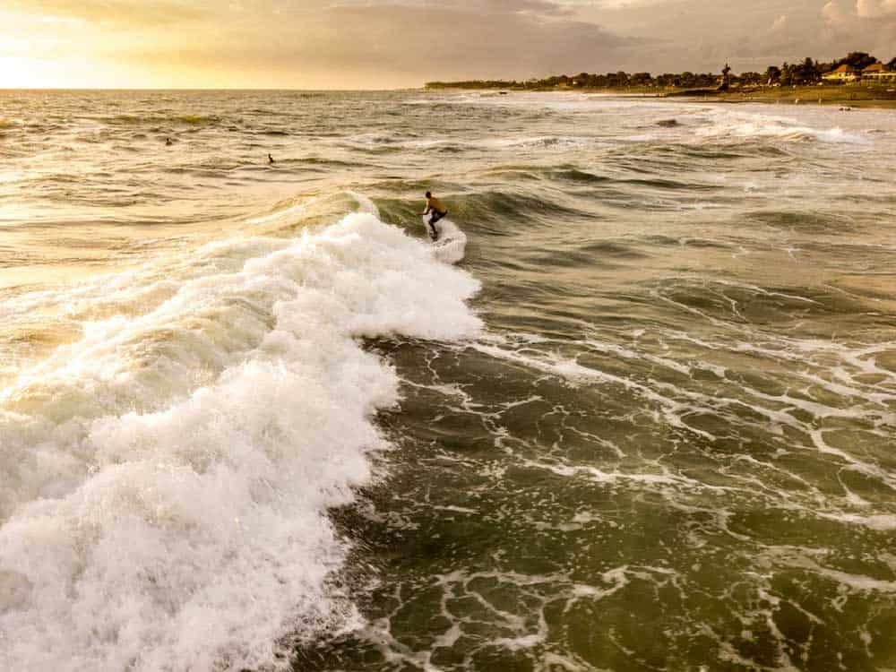Surfer @ Canggu Beach in Bali, Indonesia